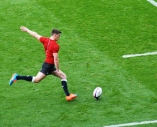 Owen Farrell kicks for the posts in warm-up. Photo: John Evely