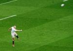 Mike Brown kicks for England. Photo: John Evely